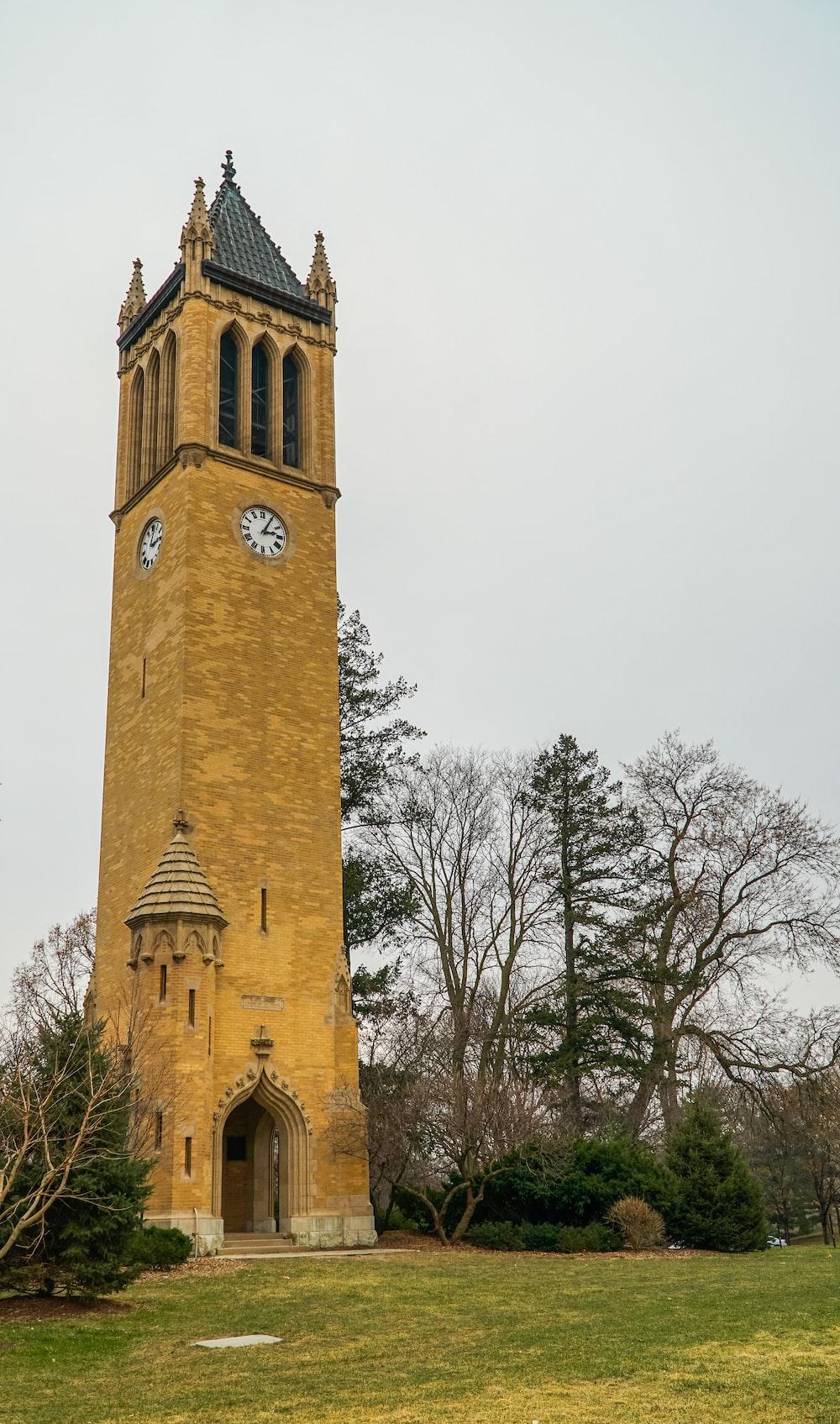 brown concrete tower clock