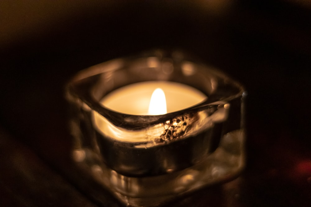 clear glass candle holder close-up photography