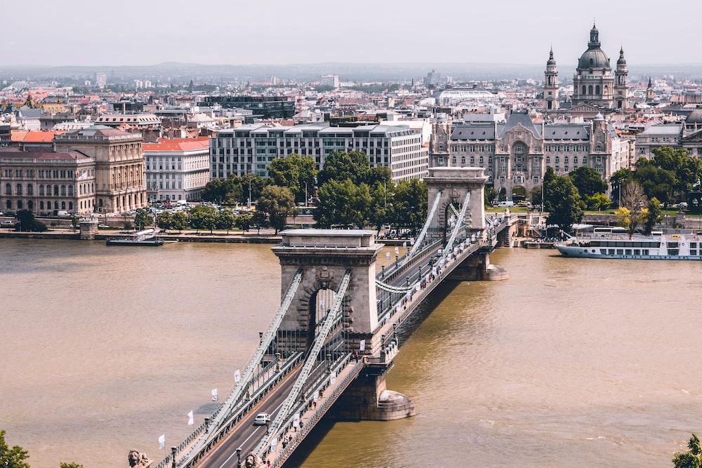 grey bridge over murky river