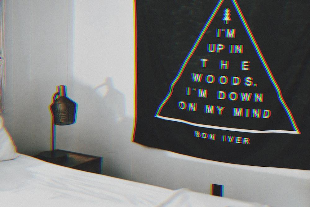 i'm up in the woods, i'm down in my mind text on black textile