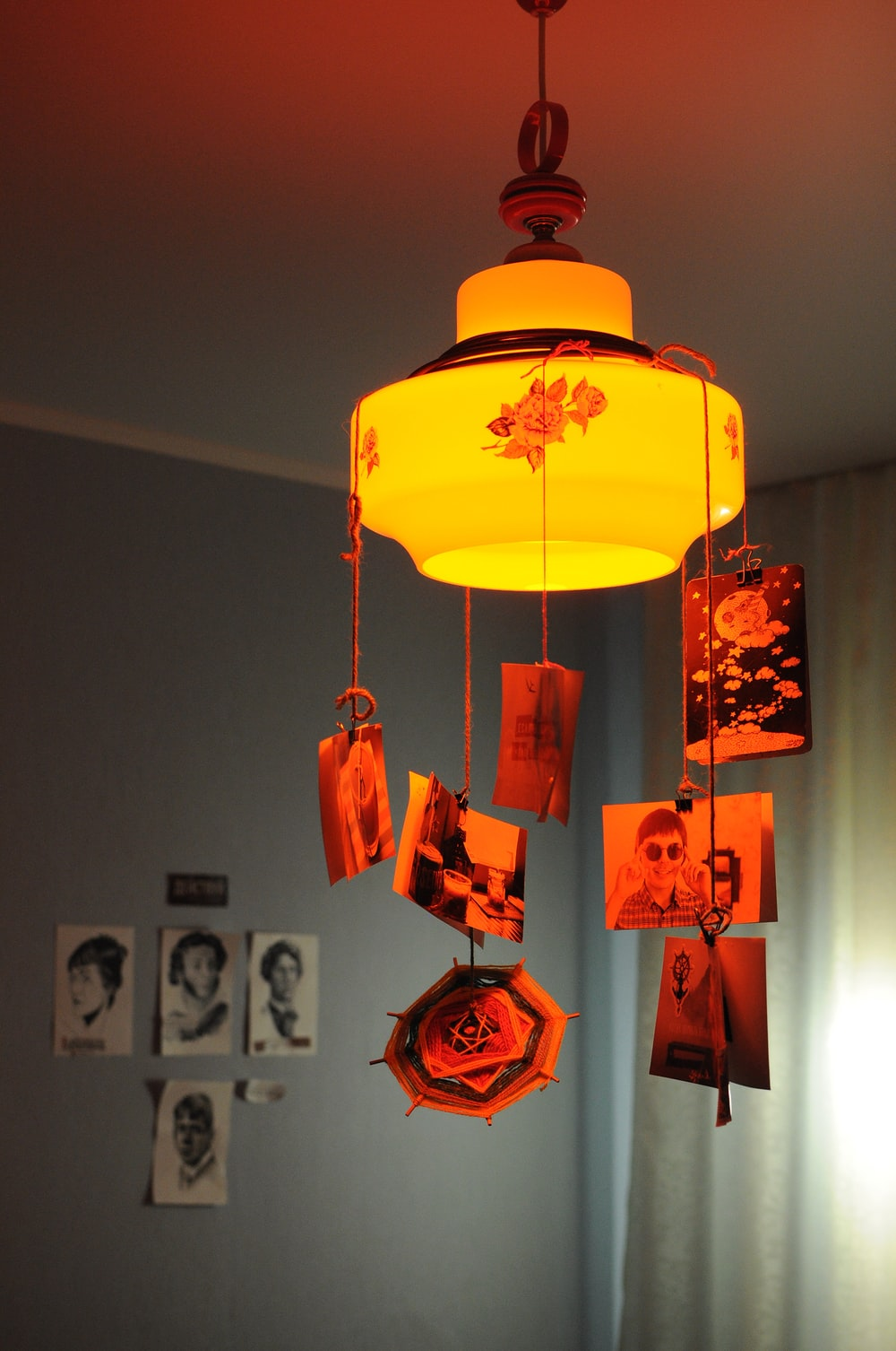 turned-on pendant lamp with hanging photos