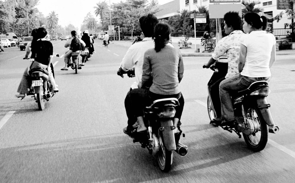grayscale photography unknown persons riding on motorcycle