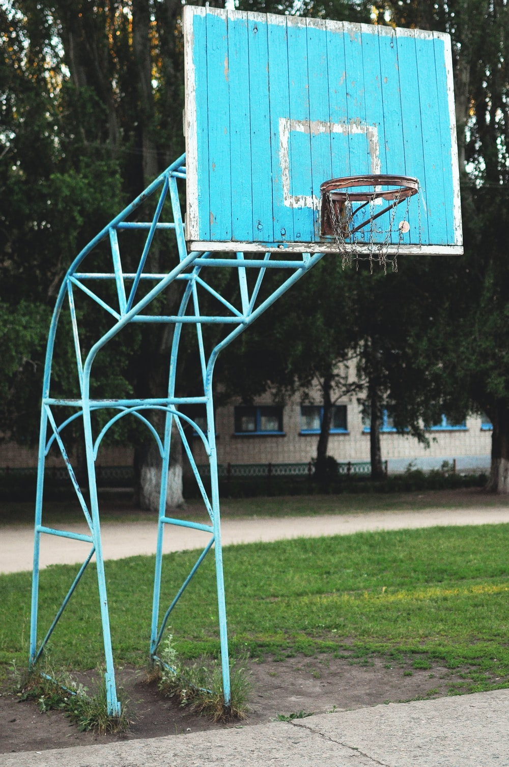 blue basketball hoop during daytime