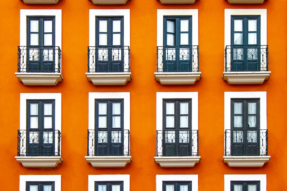close-up photography of white and orange building during daytime