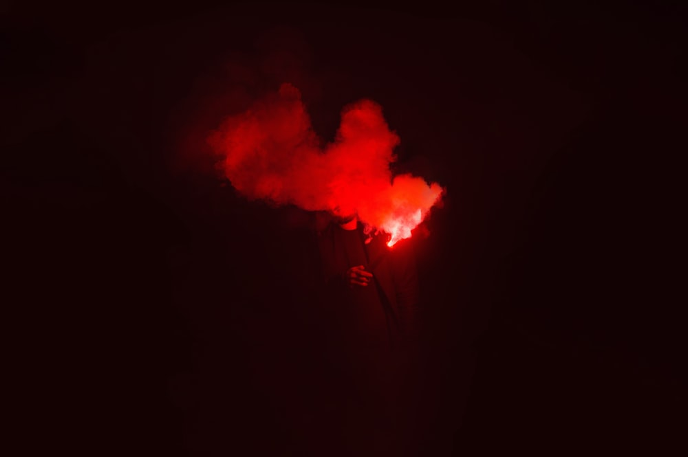 red flame in dark night