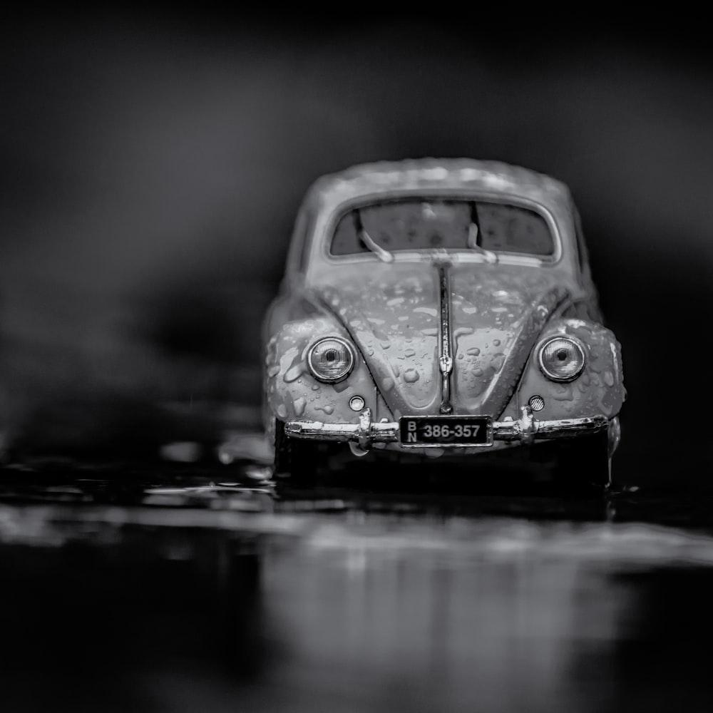 grayscale photograph Volkswagen Beetle