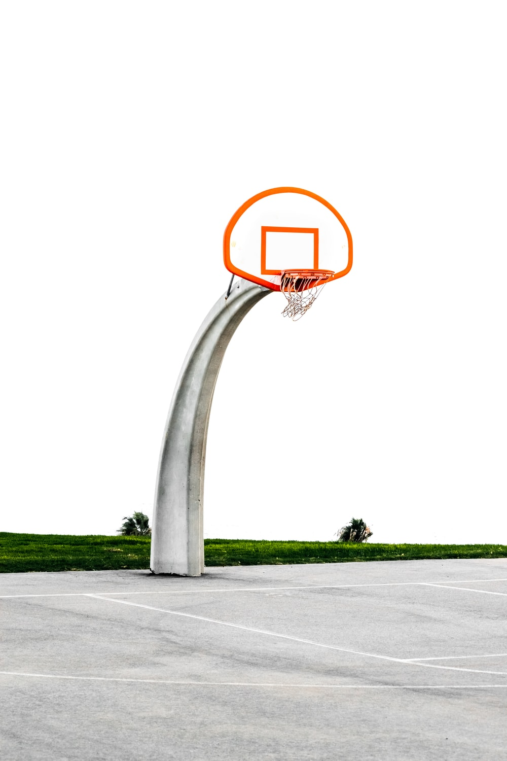 architectural photography of gray and orange basketball hoop