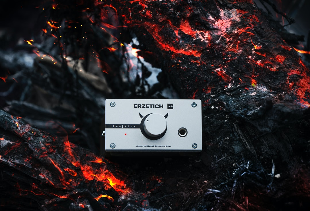 Headphone amplifier on a burning coal background.