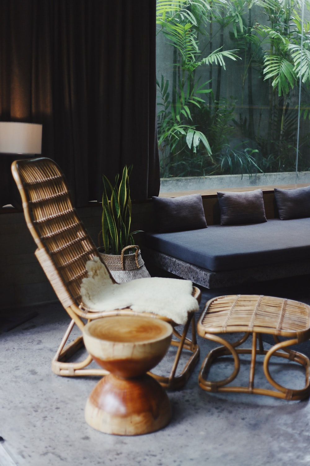 brown wooden chair beside a brown leather sofa during daytime