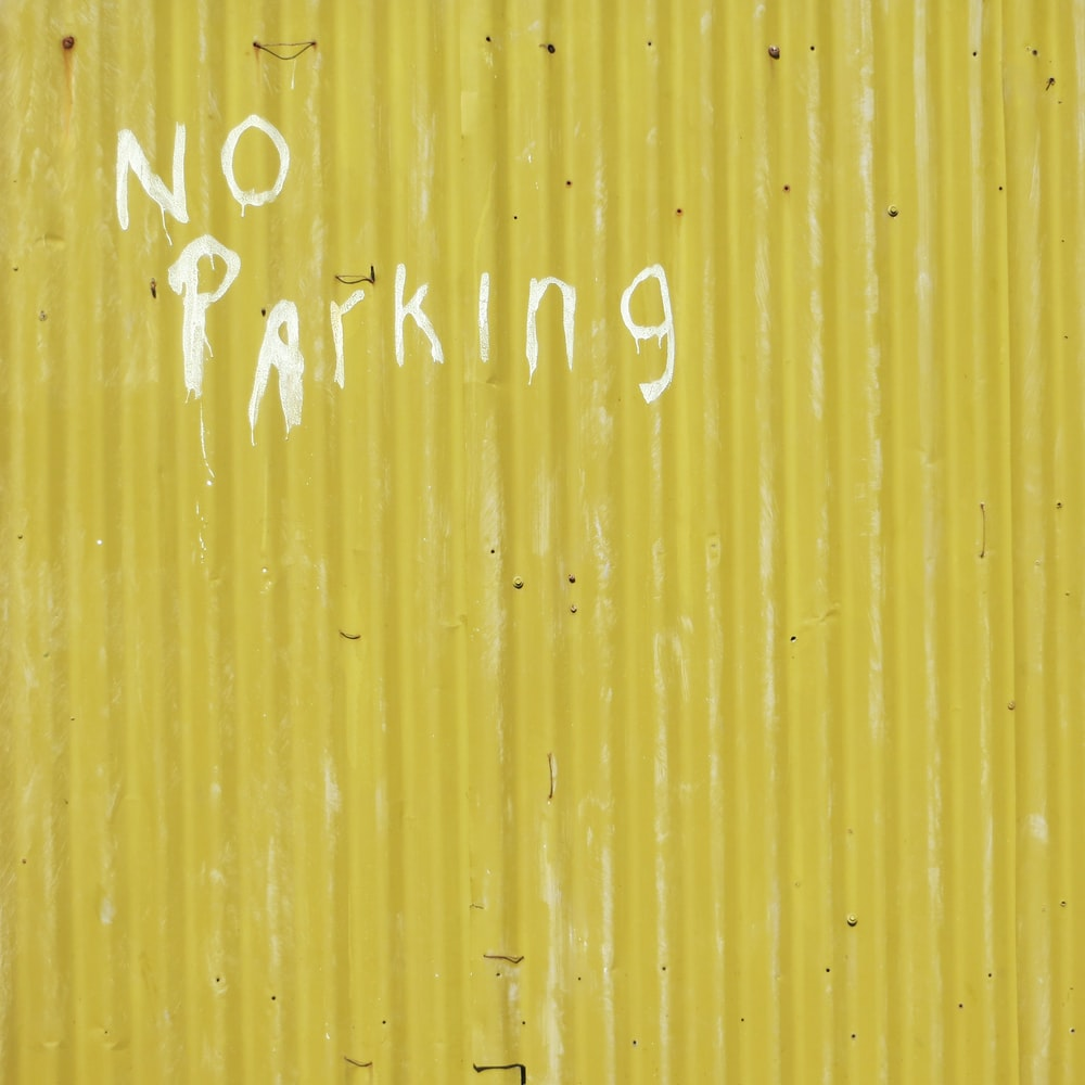 yellow wall with no parking print