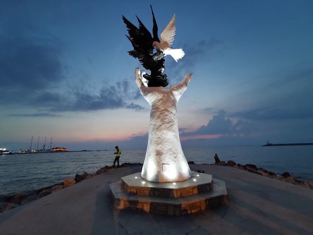 white statue across horizon during nighttime