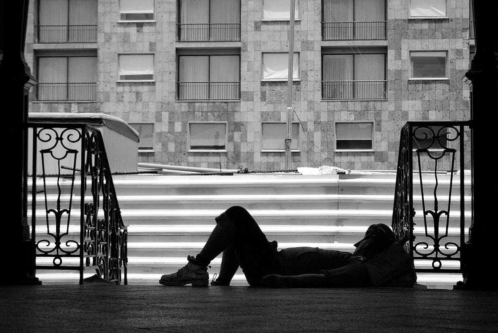 person lying near stairs