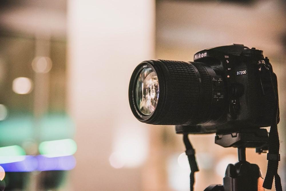black Nikon DSLR camera focus photo