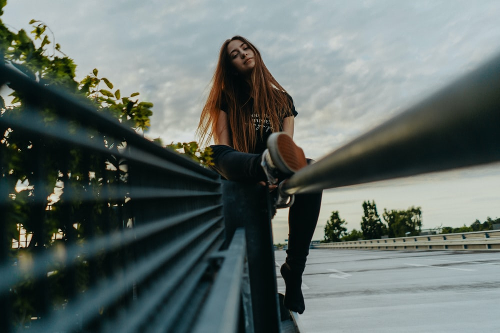 unknown person standing on handrail