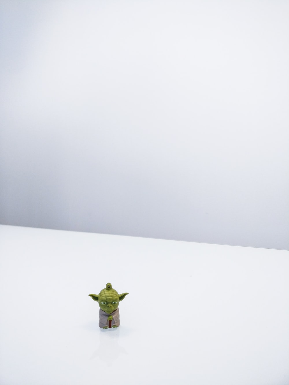 Star Wars Master Yoda minifigure on white surface