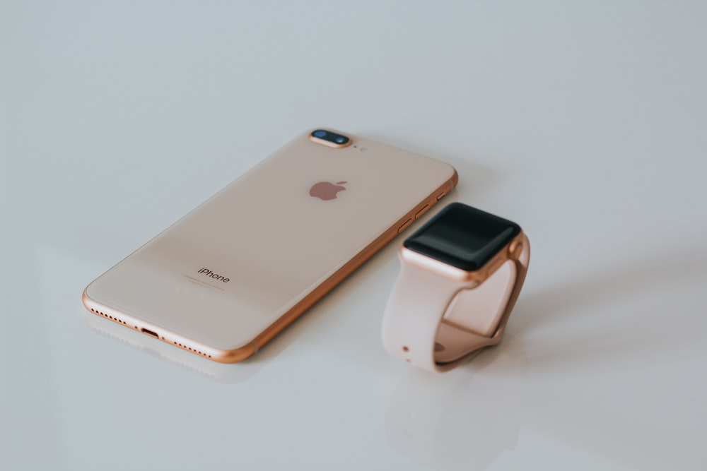 gold iPhone 8 Plus and Apple Watch