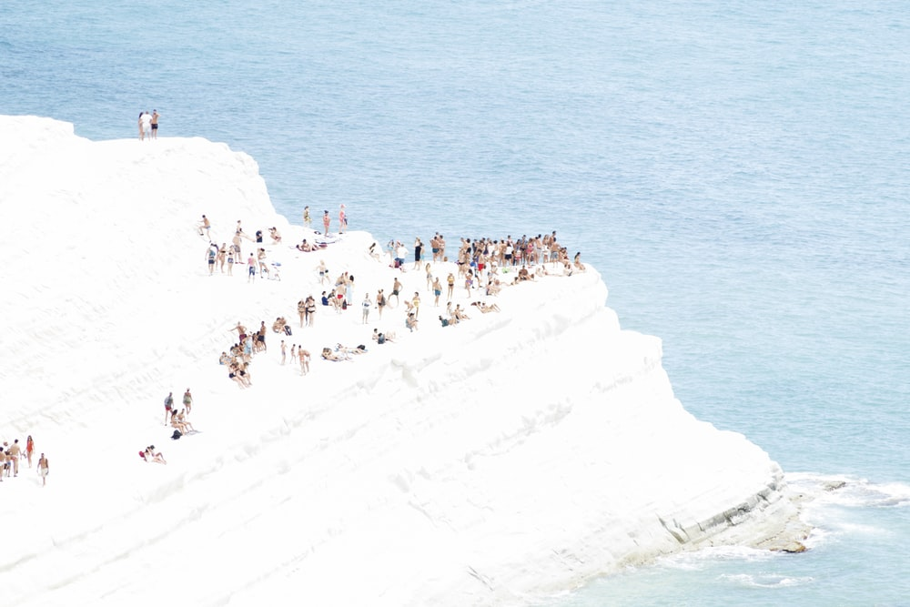 people on ice berg during daytime