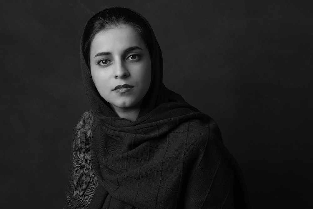grayscale photo of woman in hijab