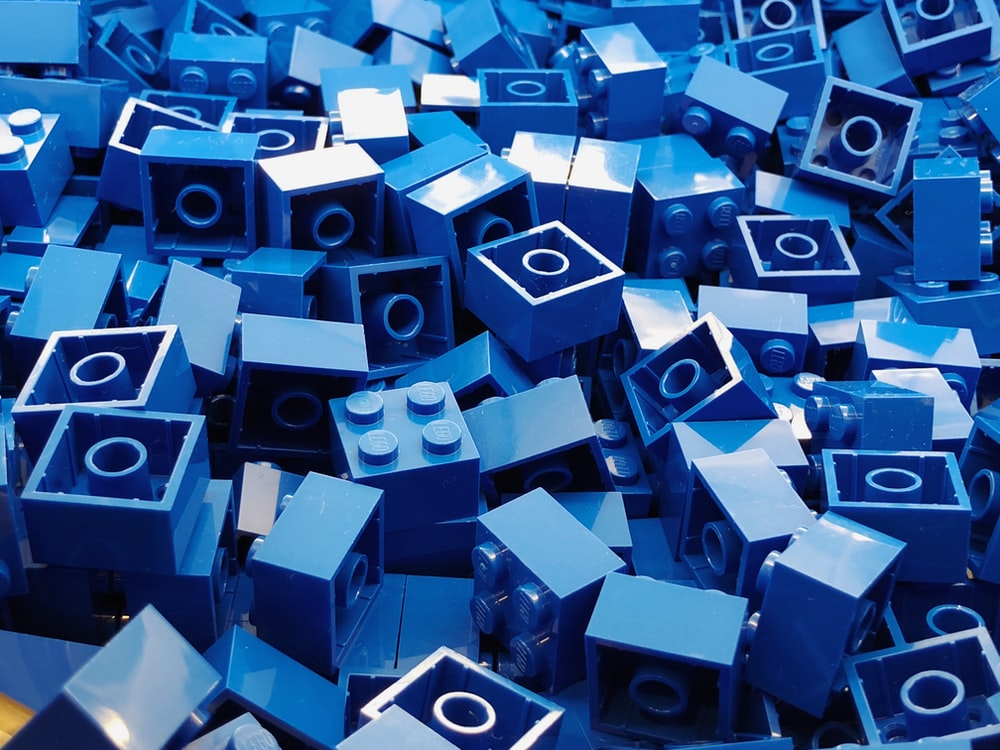 blue cube toy lot close-up photography