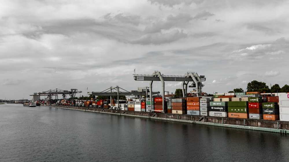 selective color photography of container crates at port