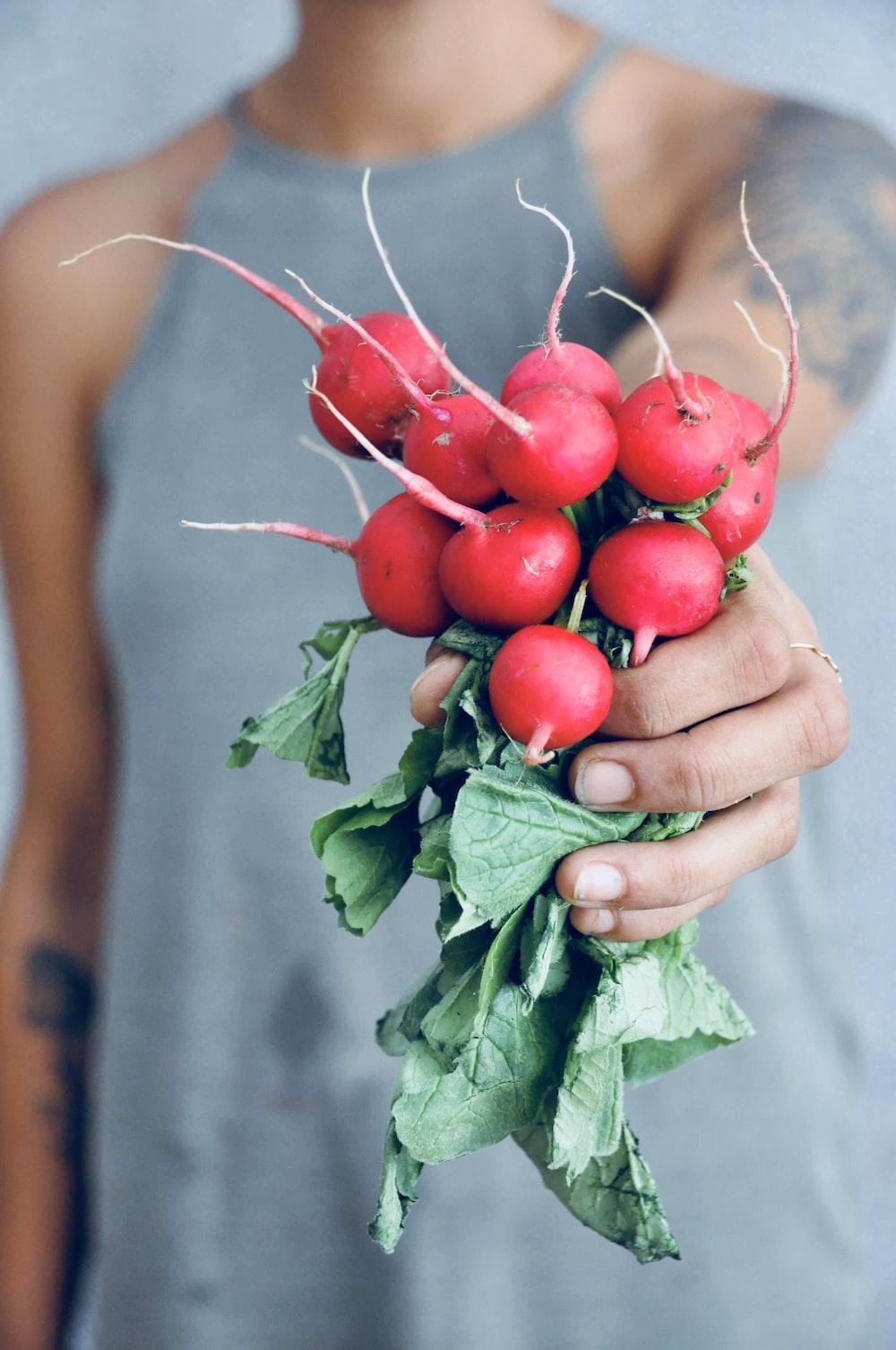 woman holding horseradish
