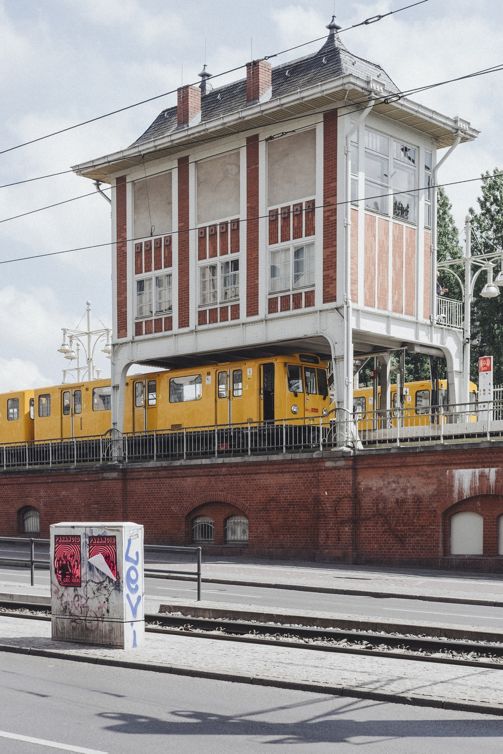 two yellow trains on railroad during daytime