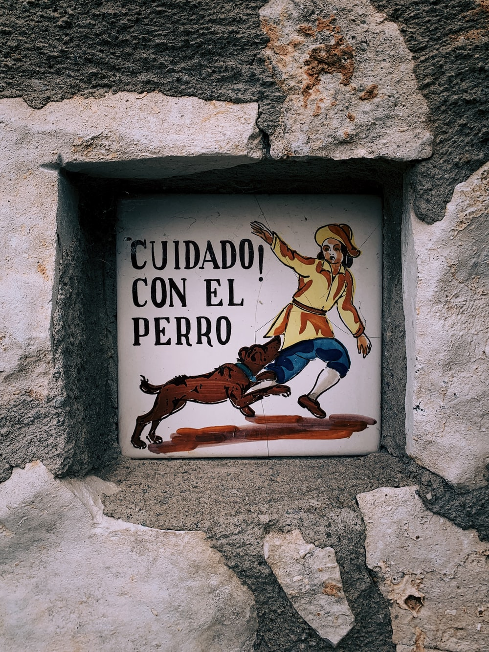 Cuidado Con El Perro wall sign