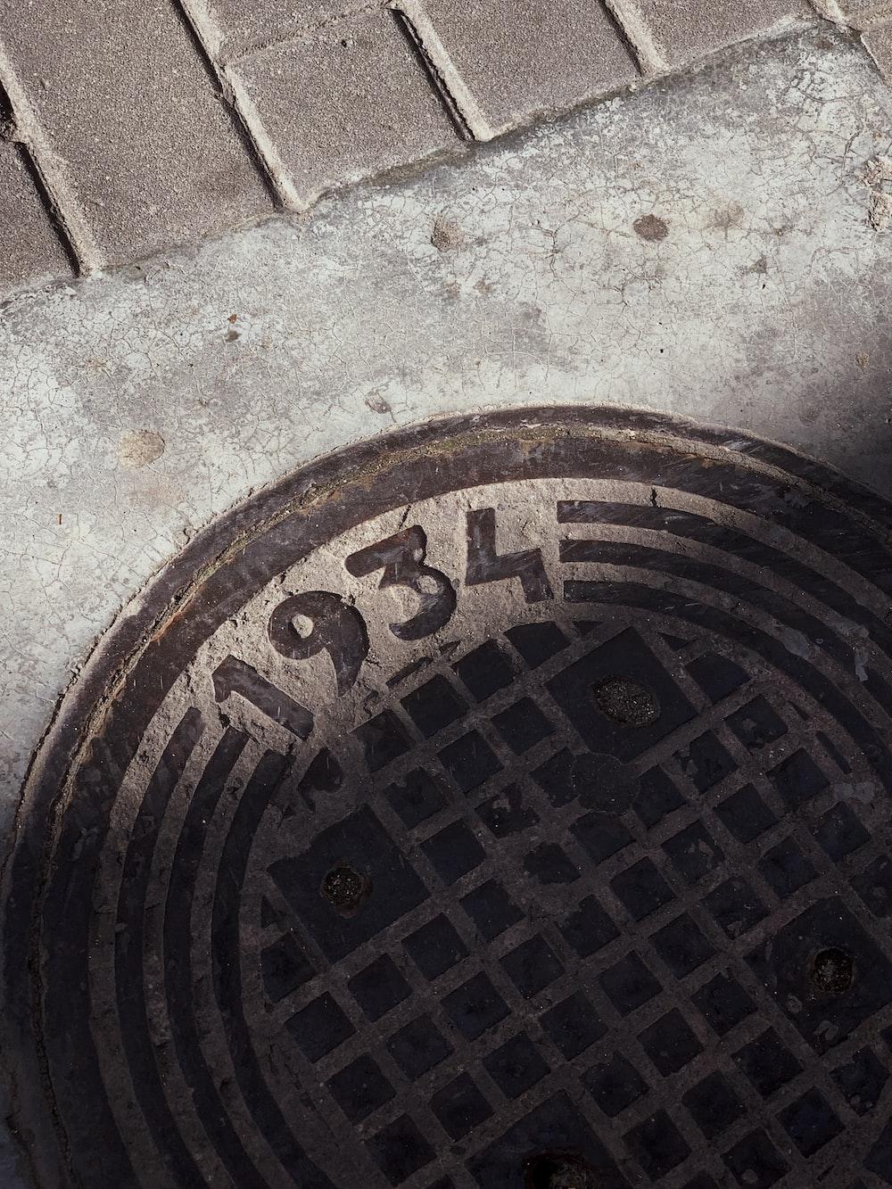 1934 manhole cover on floor
