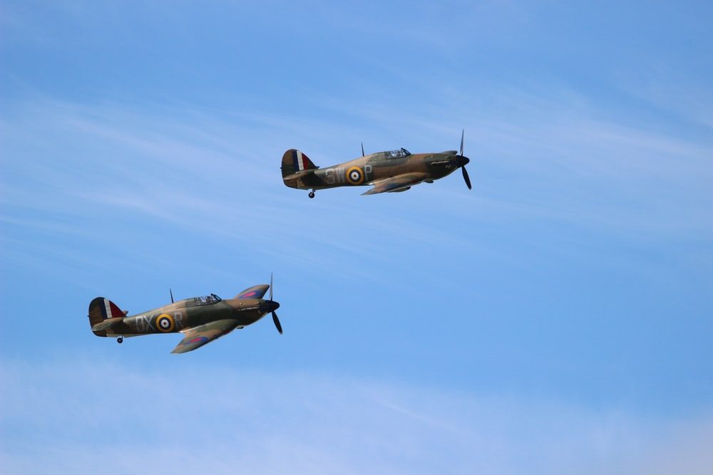 two green fighter planes flying