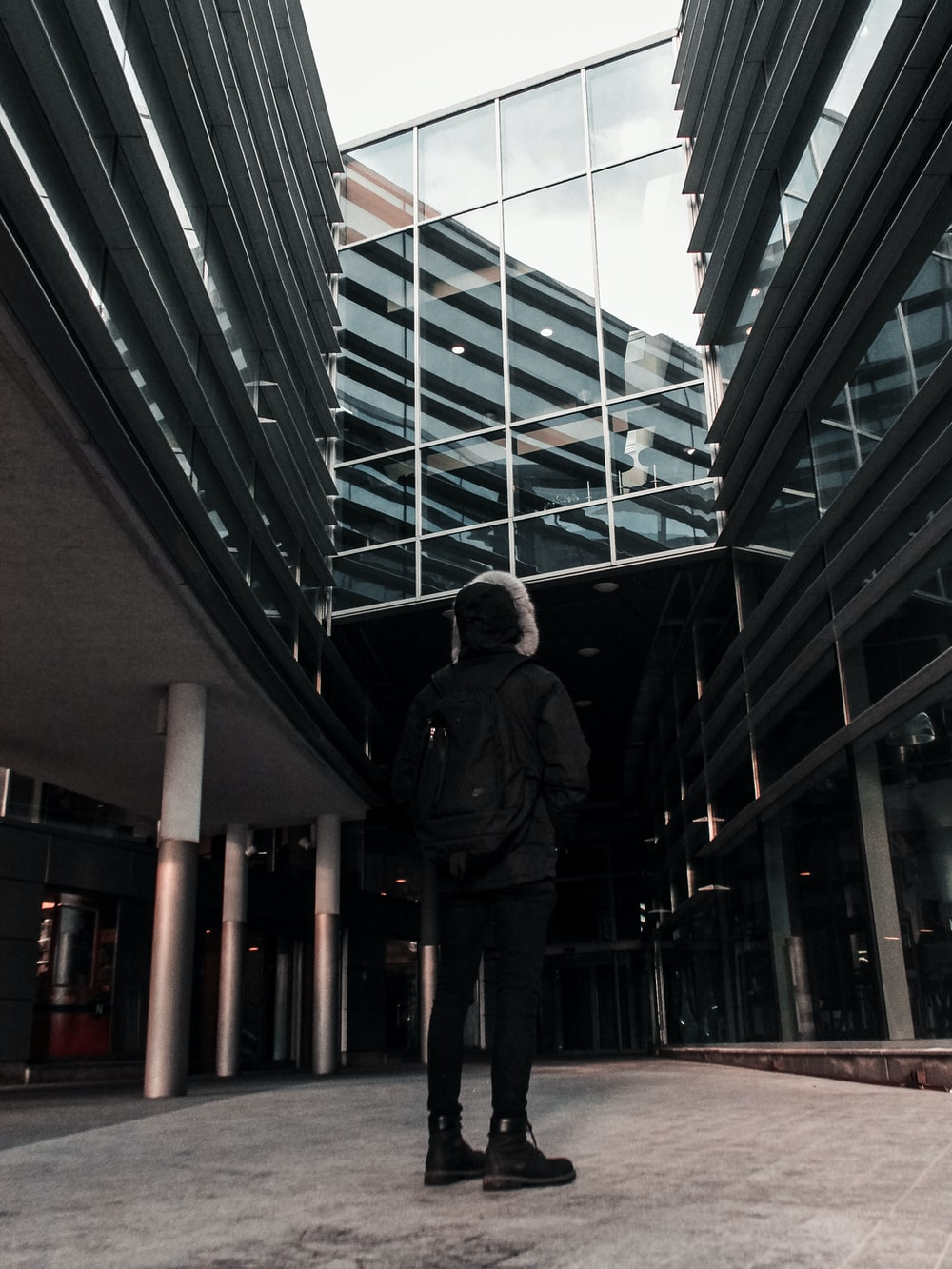 standing man looking up inside building