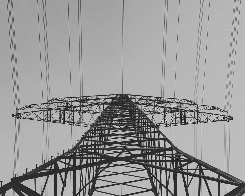 low-angle photography of transmission tower
