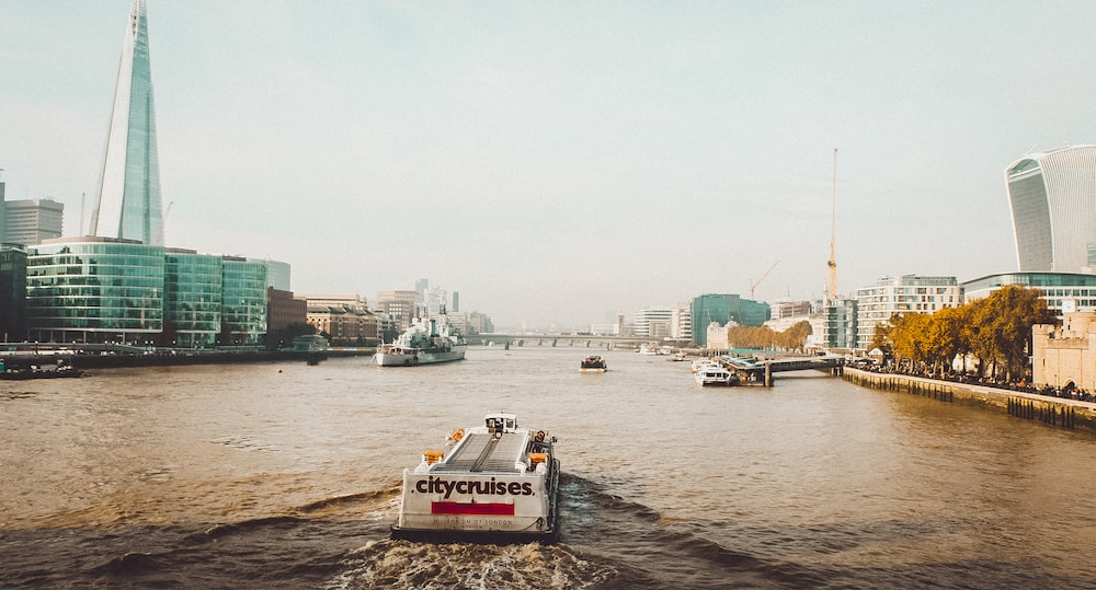 white cargo boat at river thames during daytime