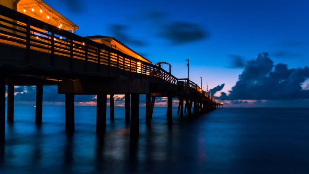 silhouette photo of wooden dock