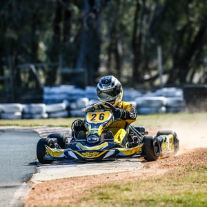 man in yellow go-kart