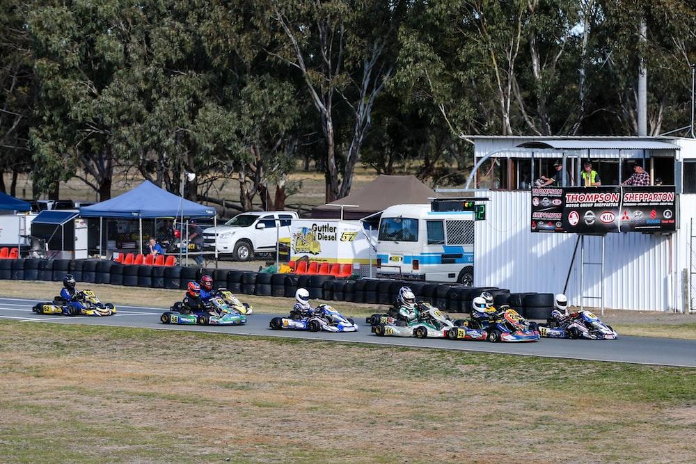 men in racing carts in track