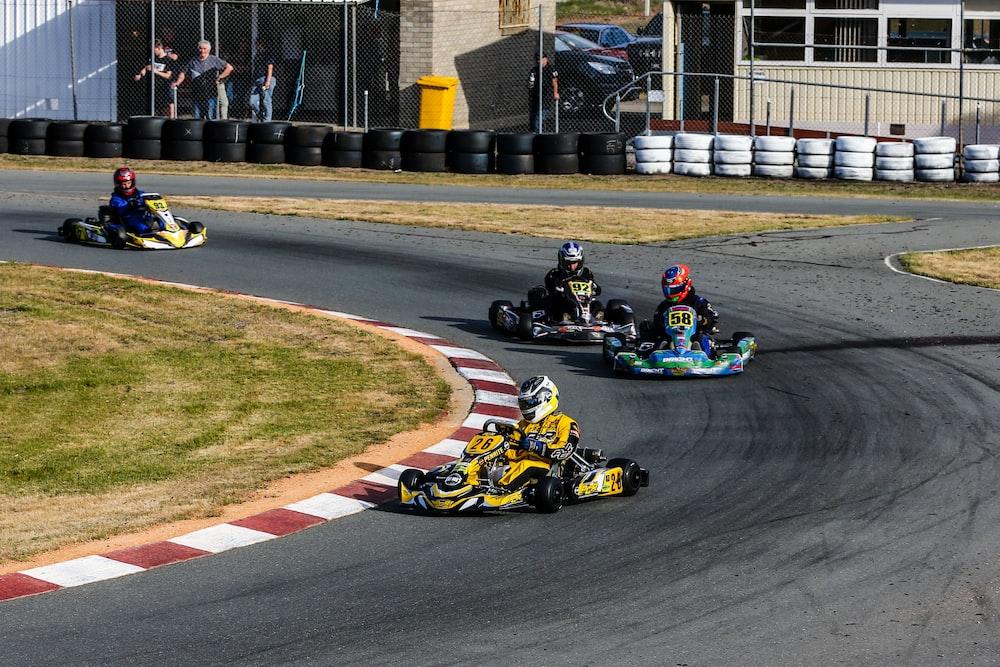men riding on go kart