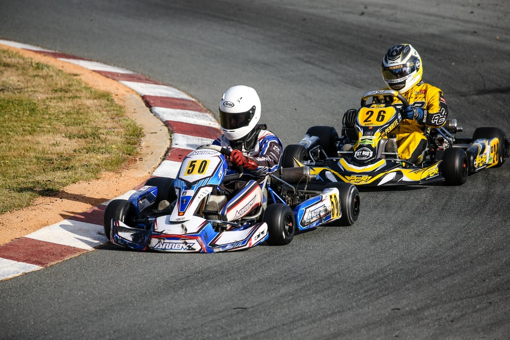 two kart racers swerving at the race track