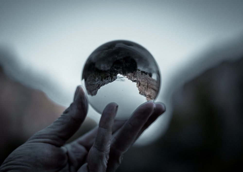 reflection of landscape in clear glass ball