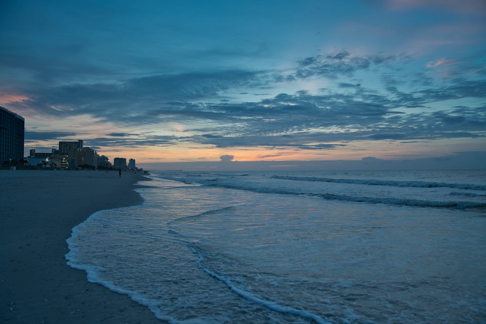 orange and blue sky at sunset over beach