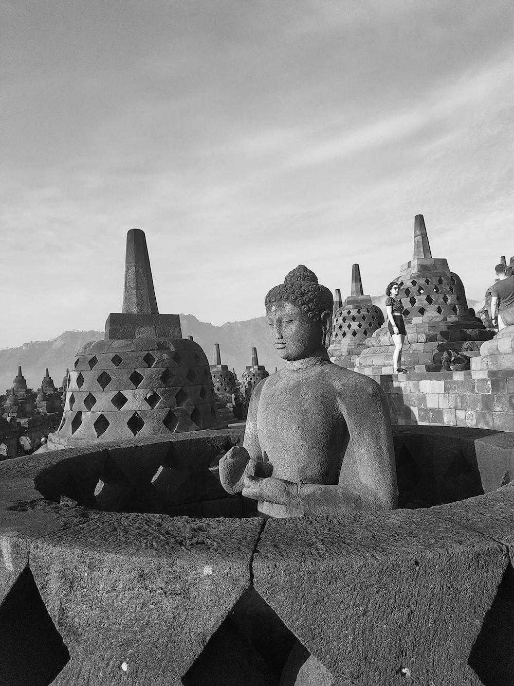 grayscale photo of Buddha statue