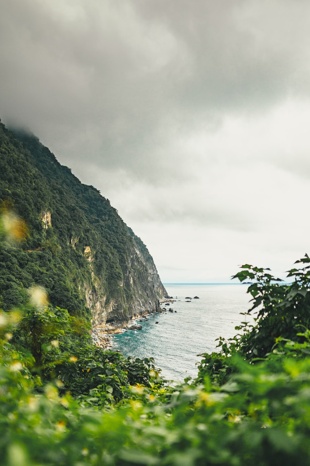 landscape photography of island beside body of water