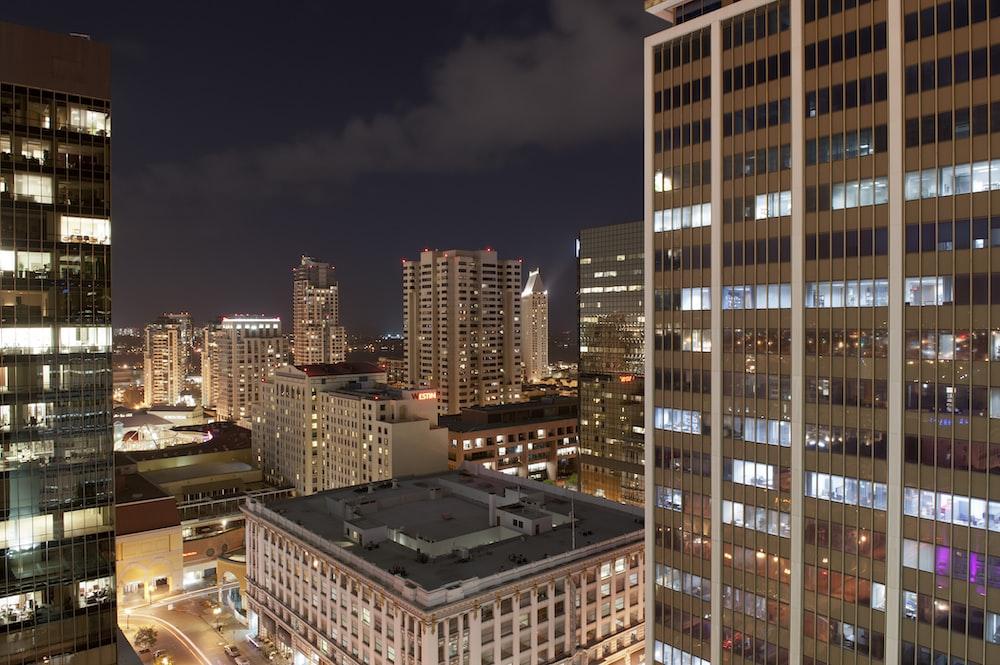 urban photo of brown buildings at night