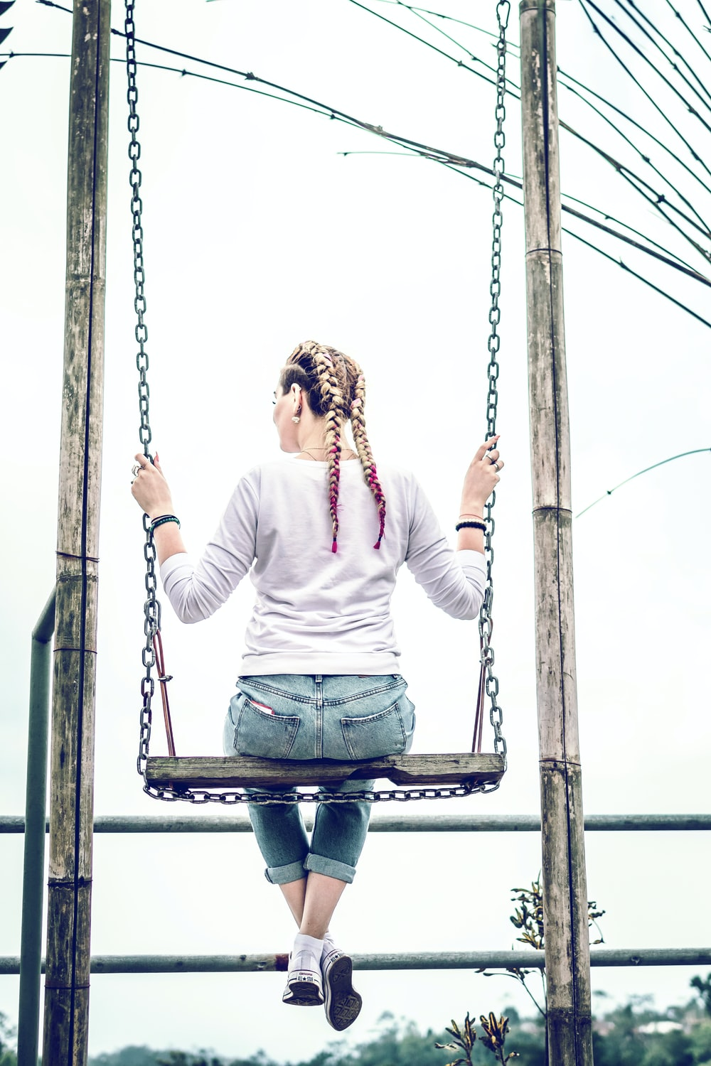 woman siting on swing