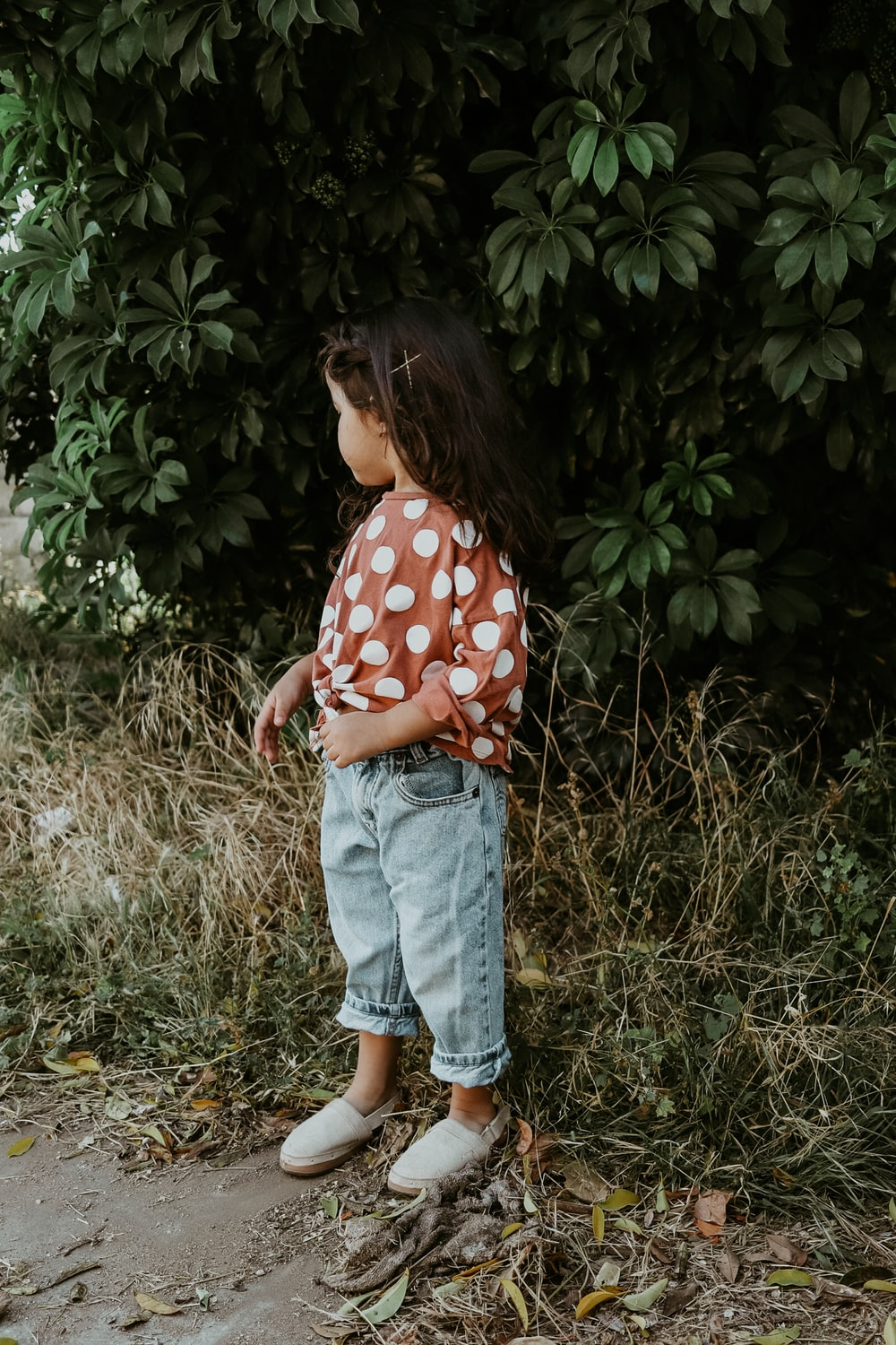girl in red and white polka dot shirt