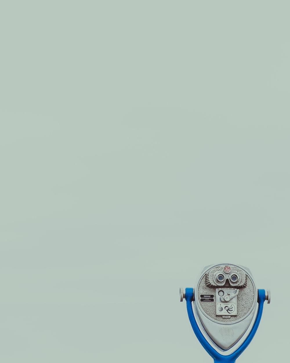 blue and gray metal binoculars