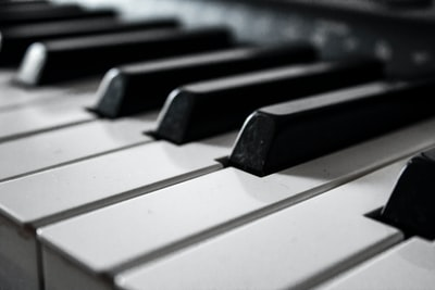grayscale photography of piano piano zoom background