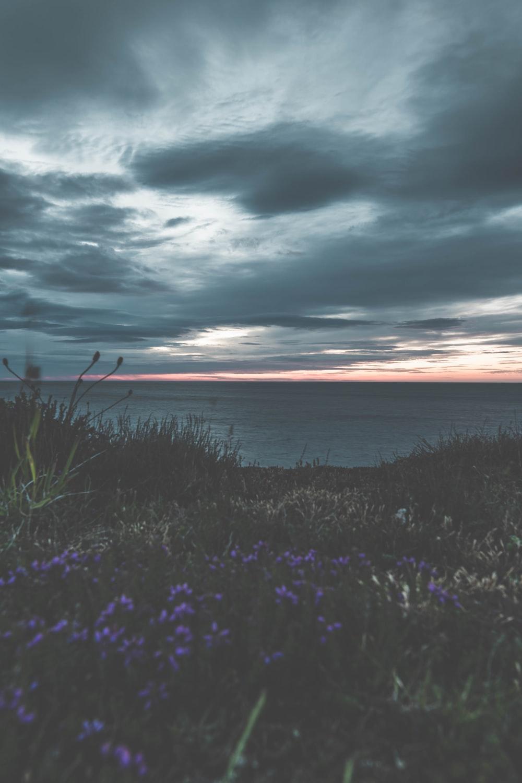 orange and grey sky over sea at dusk