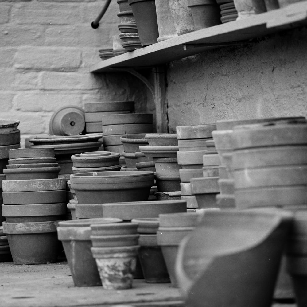 grayscale photography of clay pots