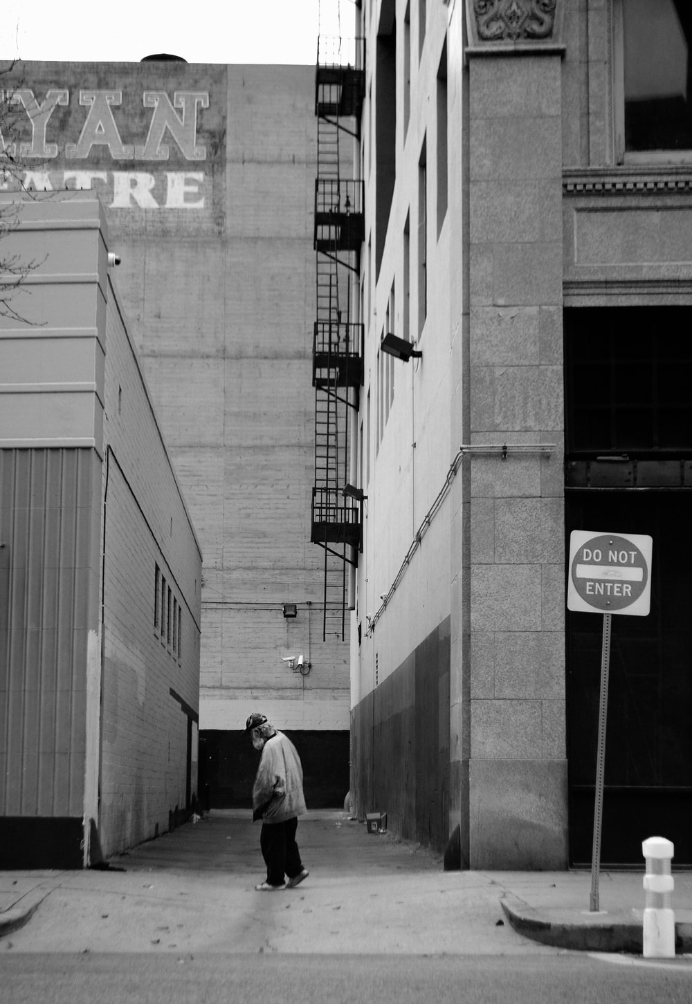 person walking on alley
