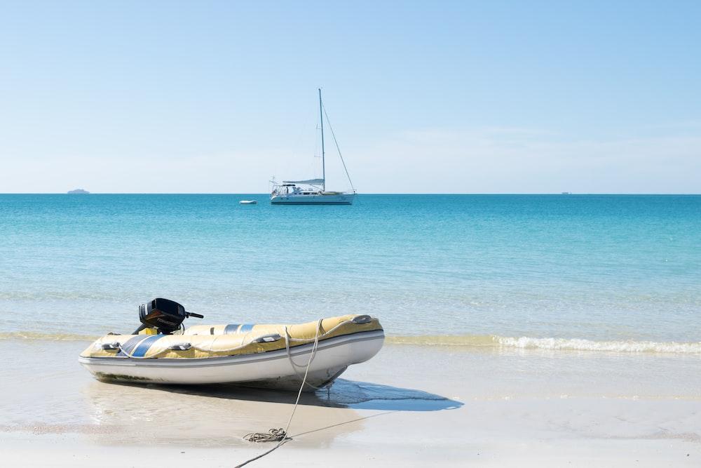 white raft on shore